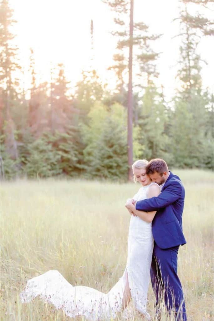 Amy and Josh Grouse Mountain Lodge Wedding in Whitefish shoulder kiss