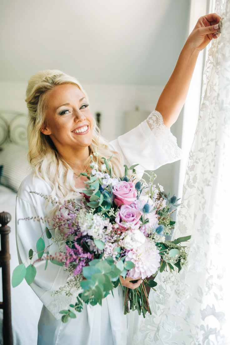 Bride-Getting-Ready-in-Bridal-Suite-with-Flowers