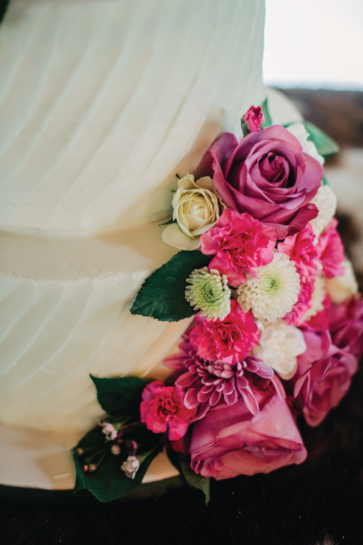 White-Cake-with-Florals-Closeup-Mountainside-Wedding