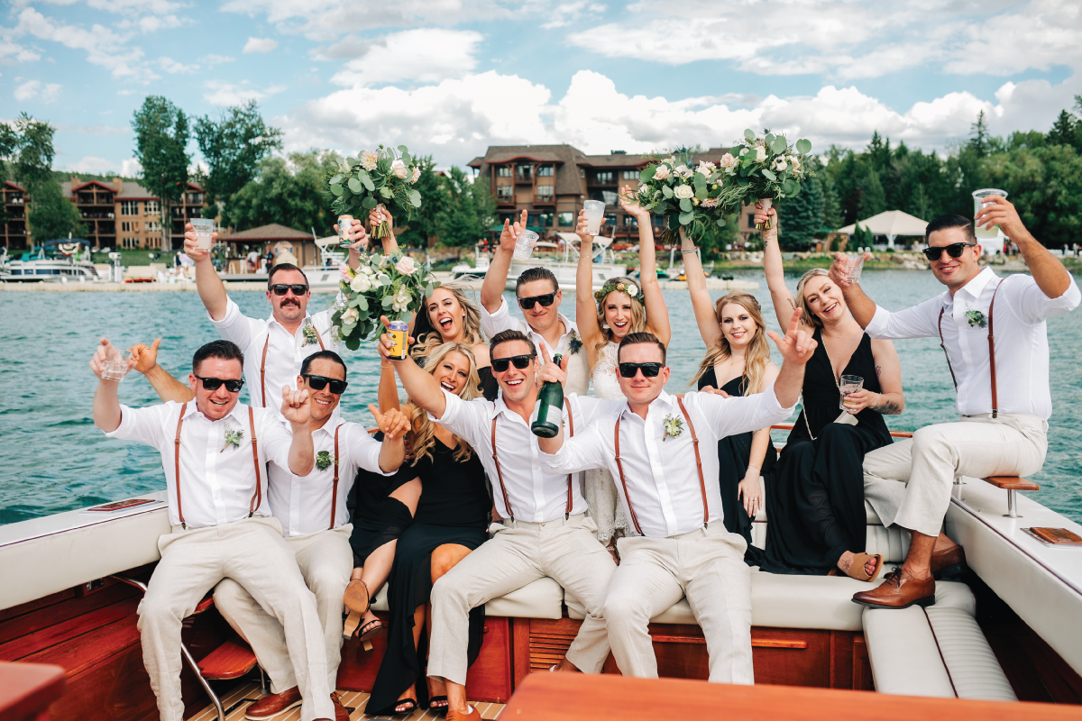 Brittany-and-Zach-Whitefish-Lake-Wedding-Boat-Ride-Wedding-Party-Fun-Photo