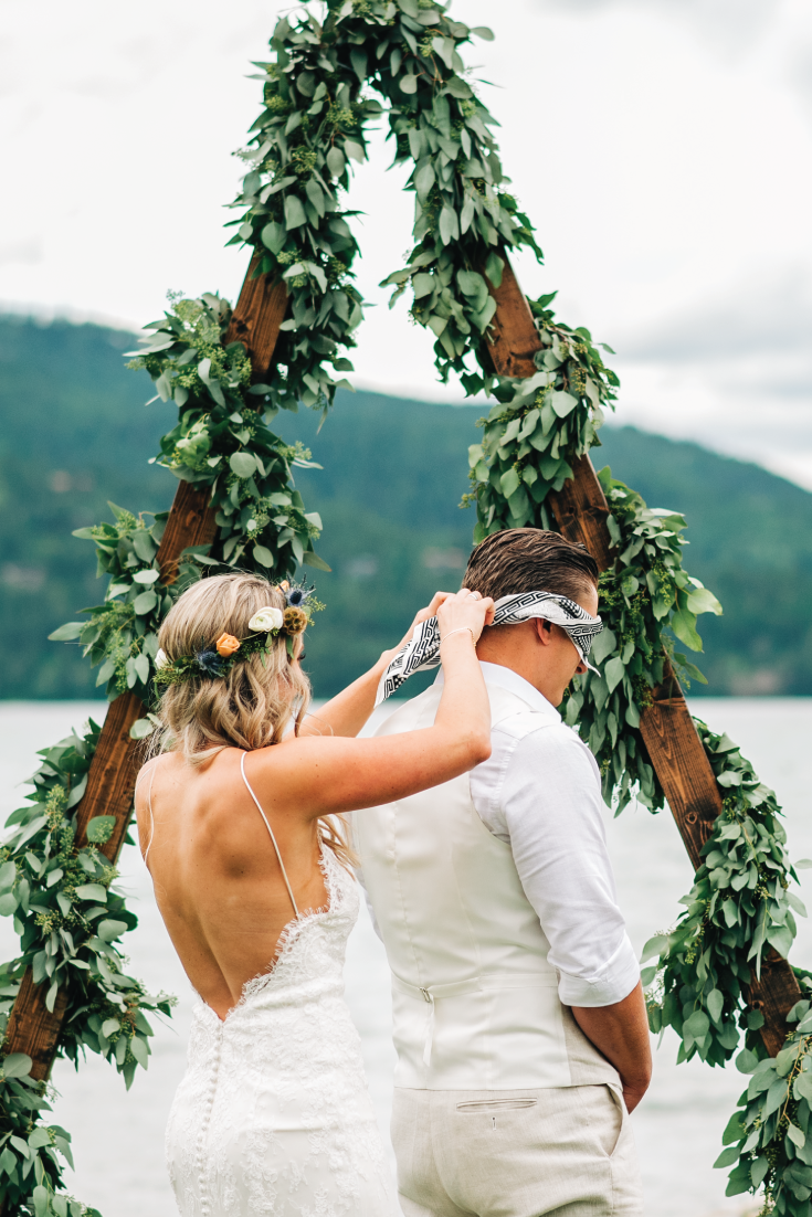 Brittany-and-Zach-Whitefish-Lake-Wedding-First-Look-Surprise-Blindfold-Untie